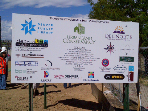 Sign showing partners involved in Mile High Vista